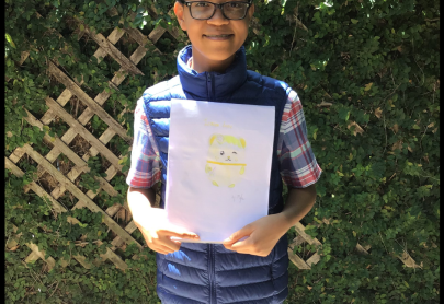 Myles with his winning drawing from the art contest!